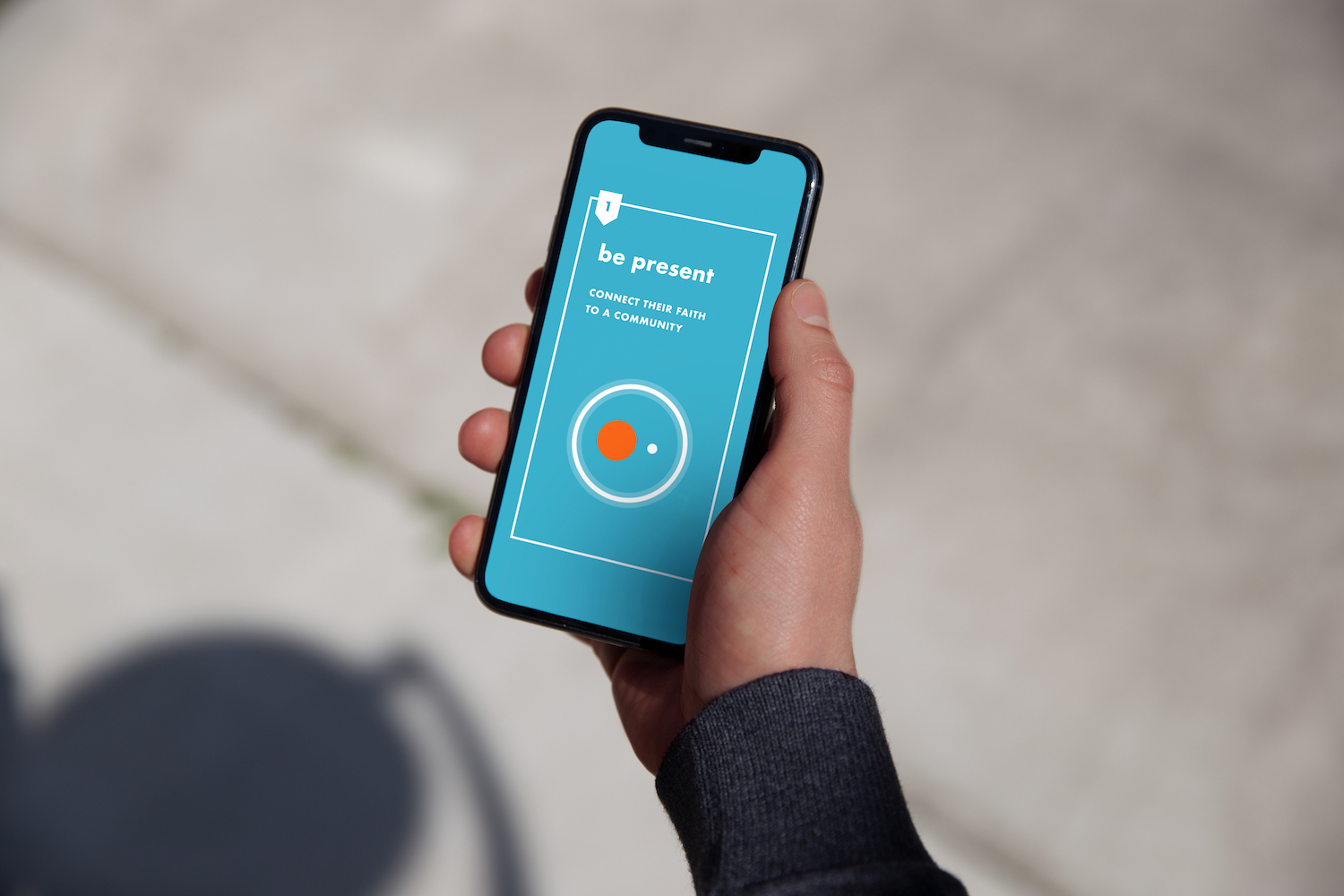 person holding a phone with orange membership resource